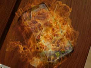Sự thật đằng sau IOS14 bị lỗi nóng máy hao pin vì phôi sim